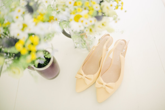 egg-shell-color-shoes with yellow flowers