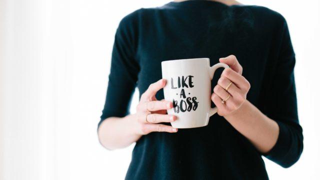 likeaboss woman holding a mug